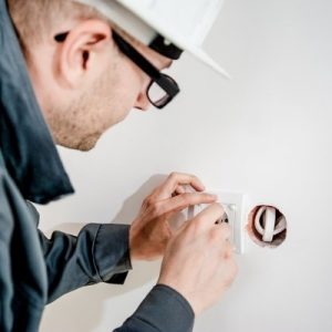 electrician installing an oulet on wall